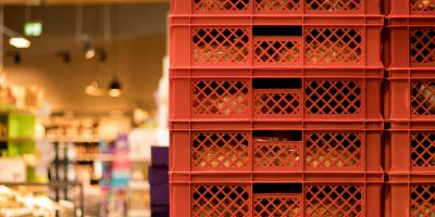 Red,Bread,Crates,Stacked,In,A,Supermarket.