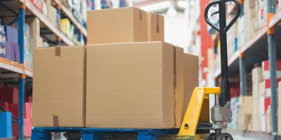 Cardboard,Boxes,On,Trolley,In,Warehouse